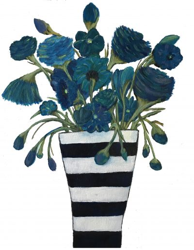 blue flowers in striped vase